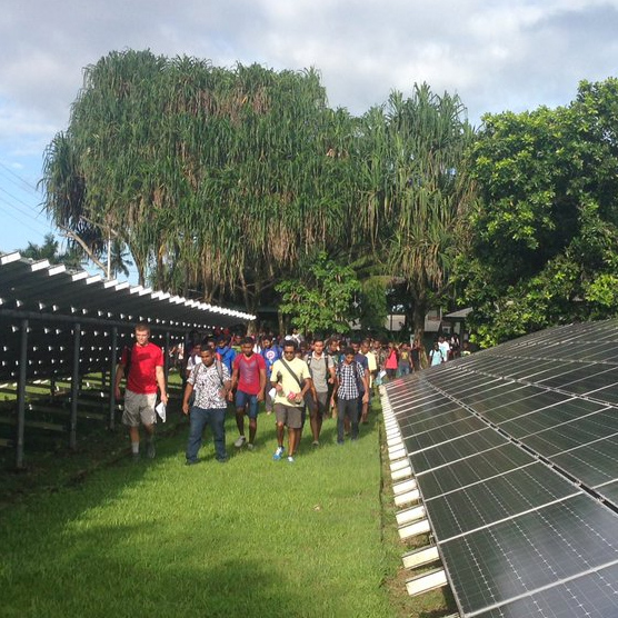 Kenny Sheffler touring a solar farm in Fiji.