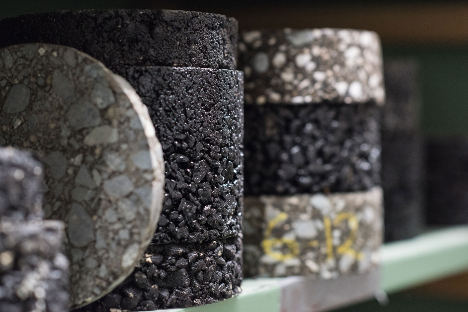 Cylinders of asphalt on a shelf