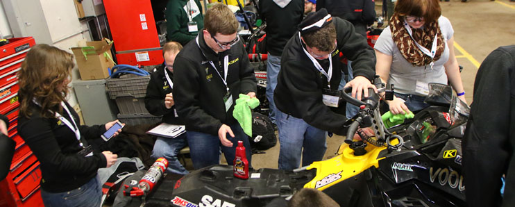 "Vandal Snowmobile team gathers around winning Hybrid Snowmobile named ""Voodoo"""