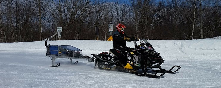 "Vandal Snowmobile ""voodoo"" driving through show in SAE International Clean Snowmobile Challenge (CSC)"