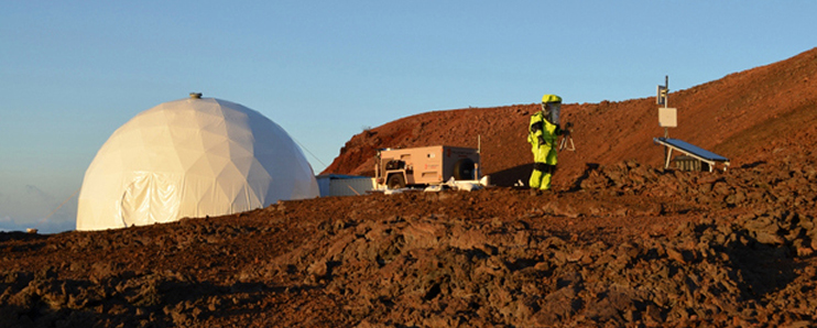 The HI-SEAS geodesic dome on the rocky landscape.