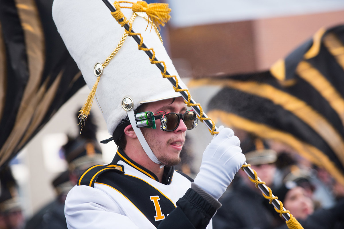 University of Idaho band member wielding baton