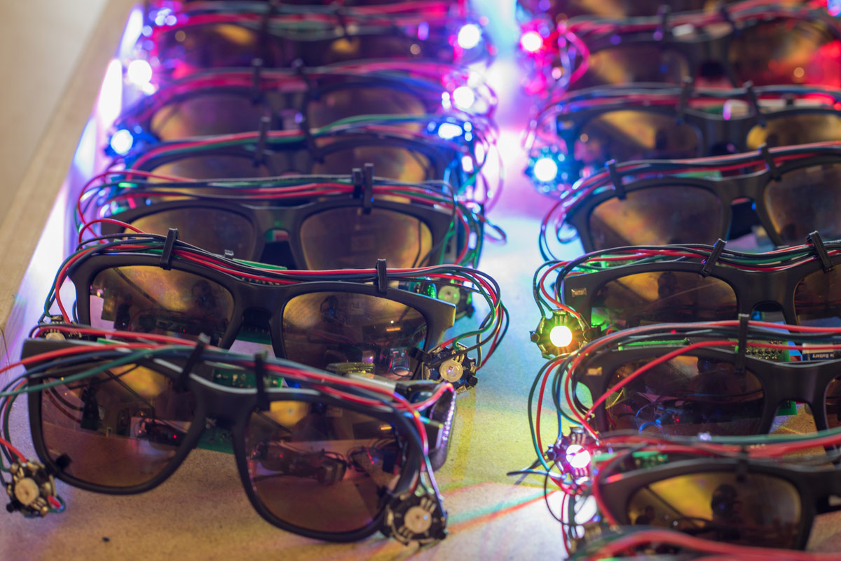 Sunglasses affixed with lights and wiring