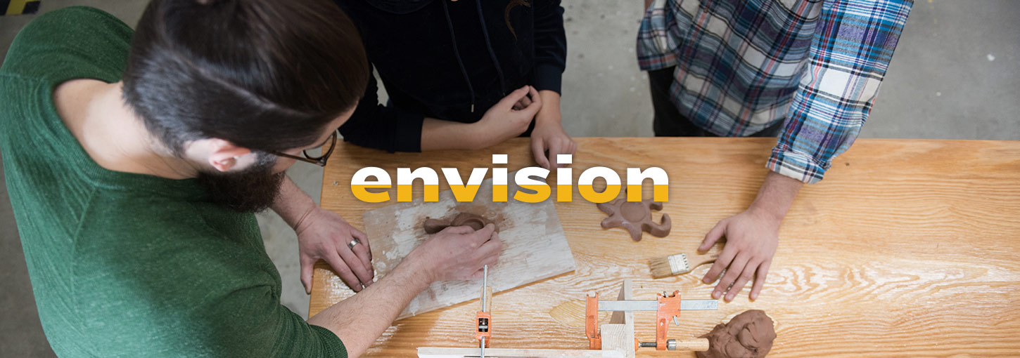 Three students sculpting clay. Text: Envision