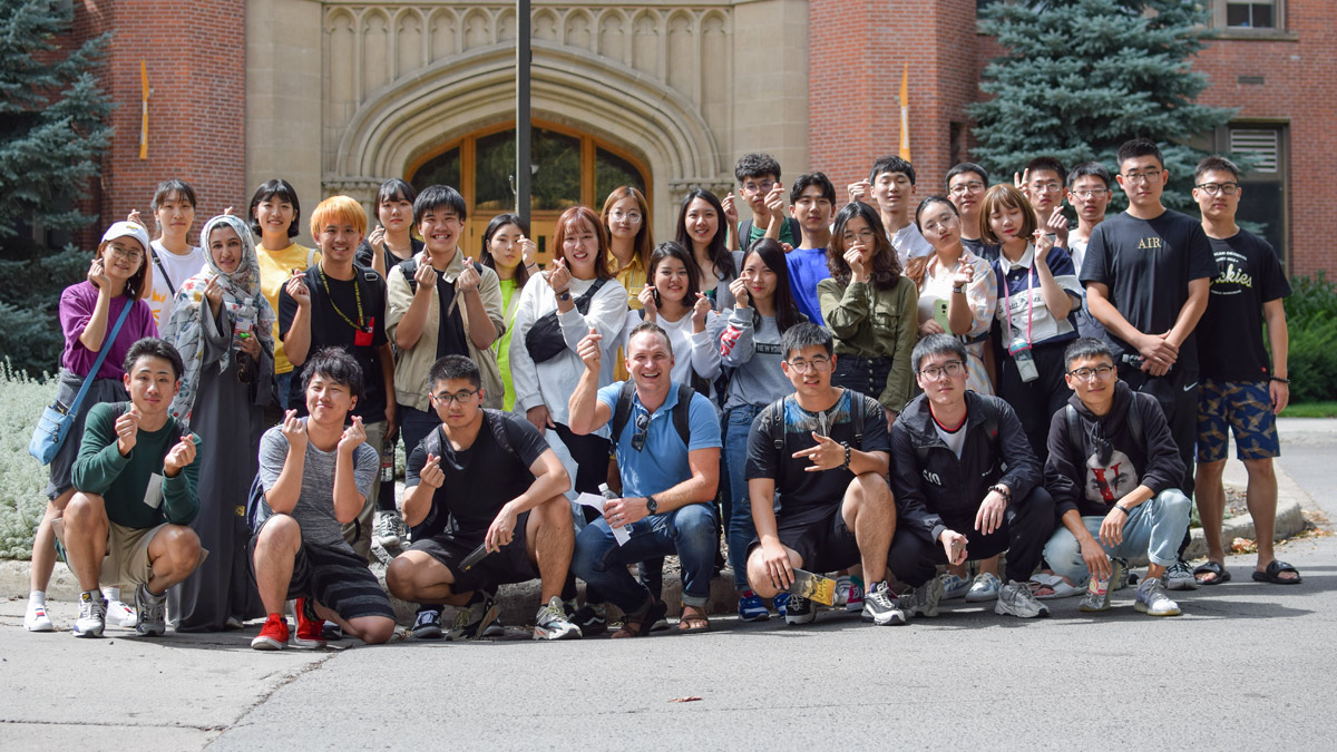 International students pose outside of the Administration Building