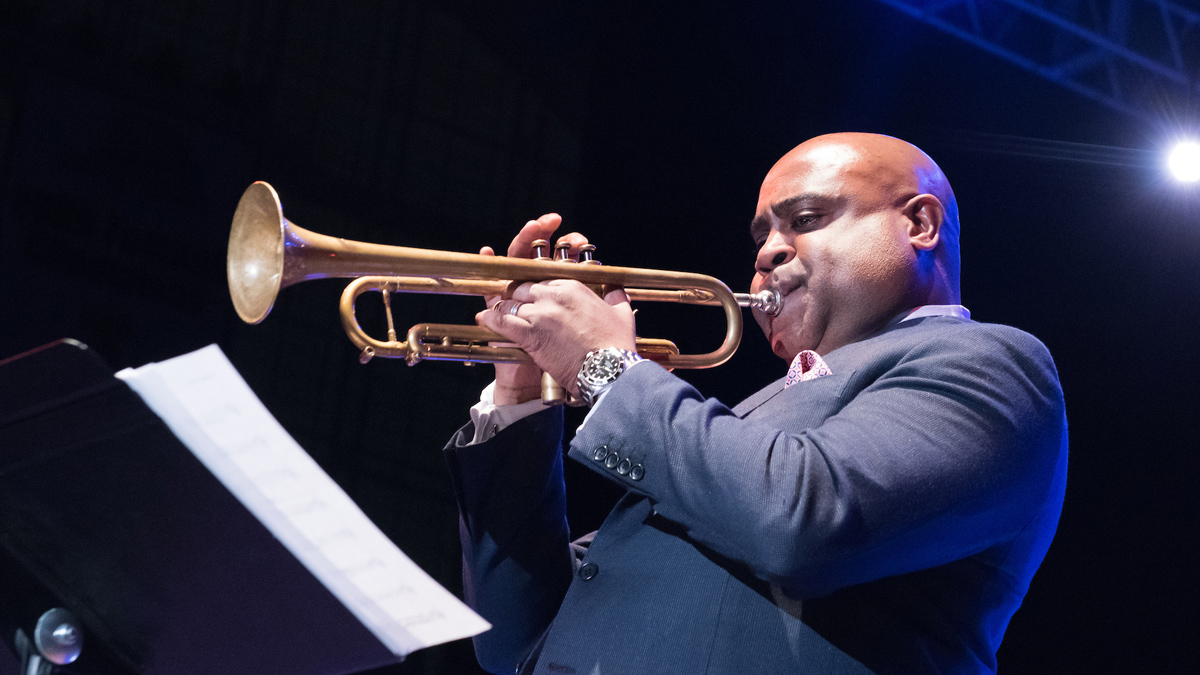 A trumpet player performs onstage