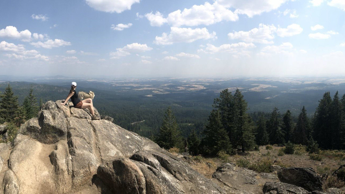 A hiker sits on Moscow Mountain.
