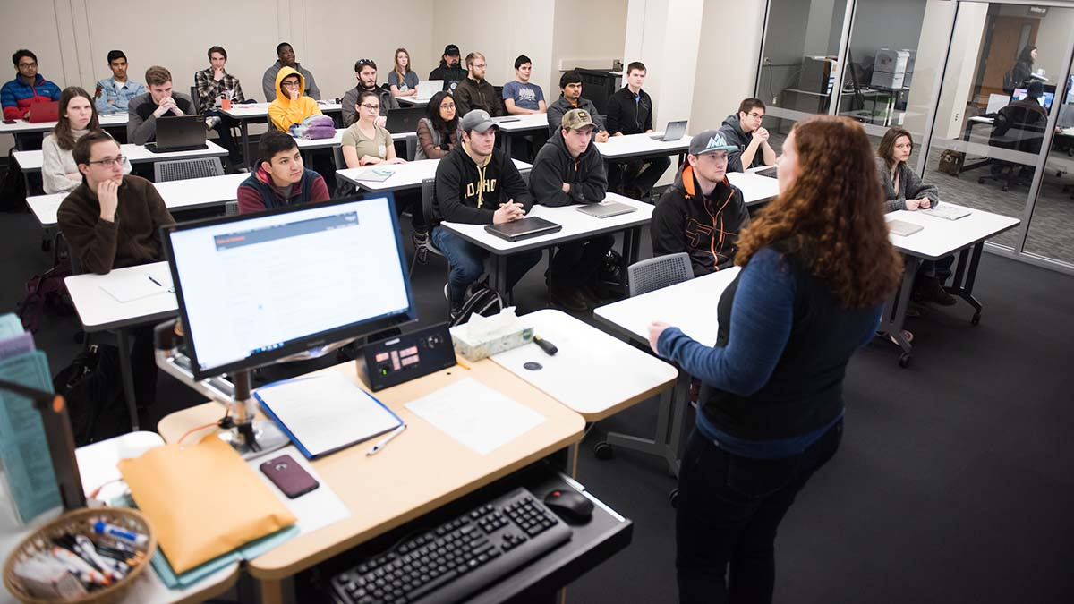 An instructor speaking to a classroom of students.