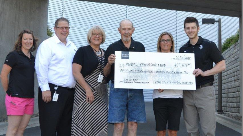 Members of the VSF proudly display a $59,000 check after a golf tournament fundraiser.