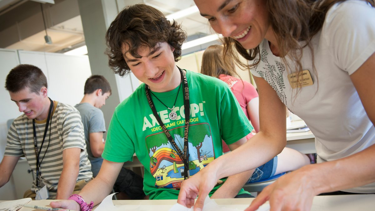 A high school student gets one on one guidance during Summer Design Week.