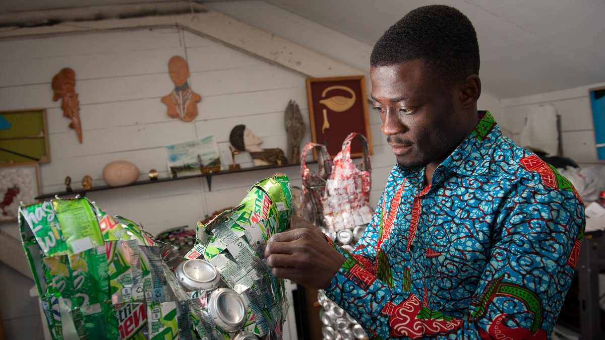CAA student creates dress-like sculptures with used soda cans.