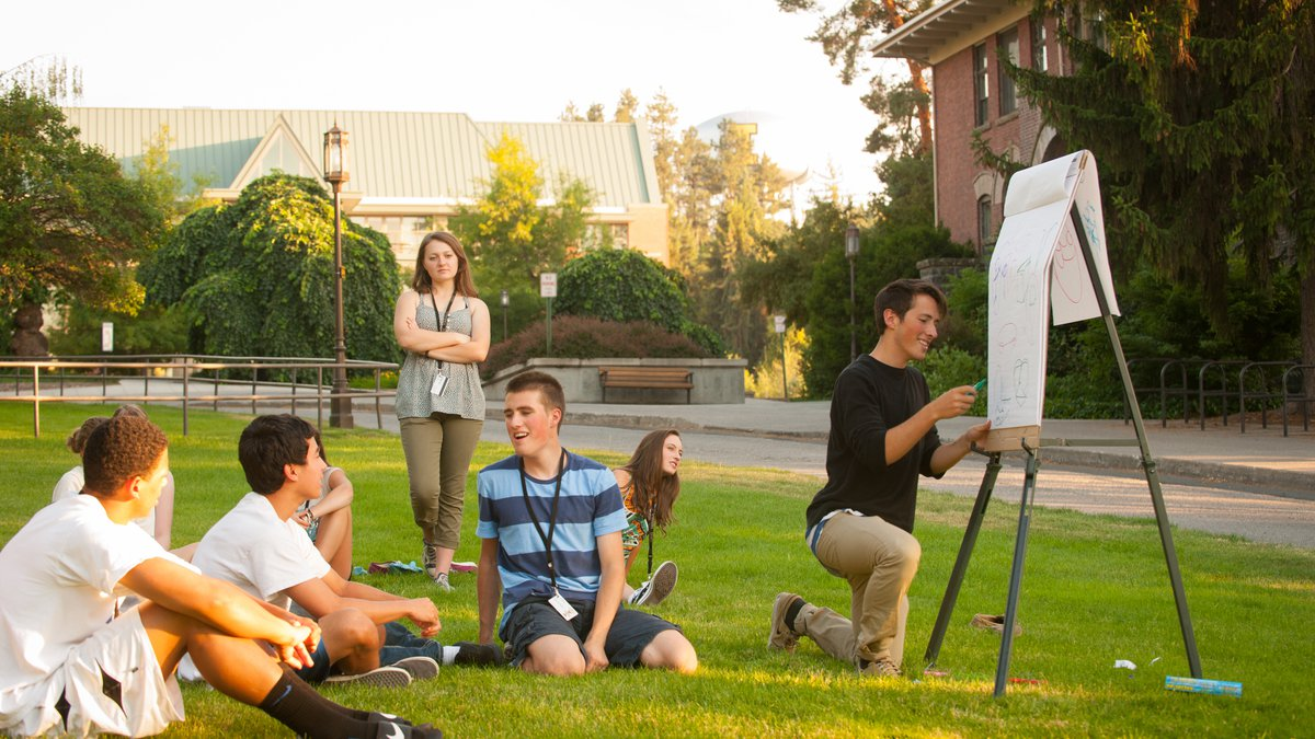 Summer Design Week, students gather outside to discuss design elements.