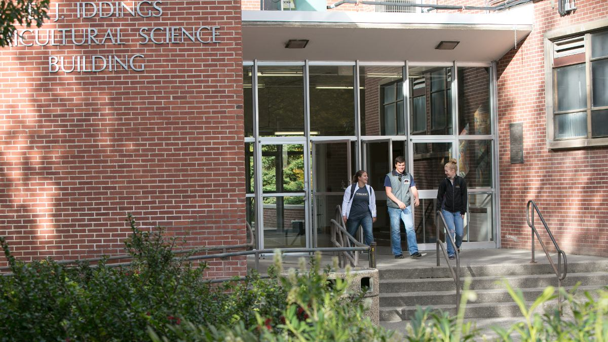 two students exiting the CALS building.