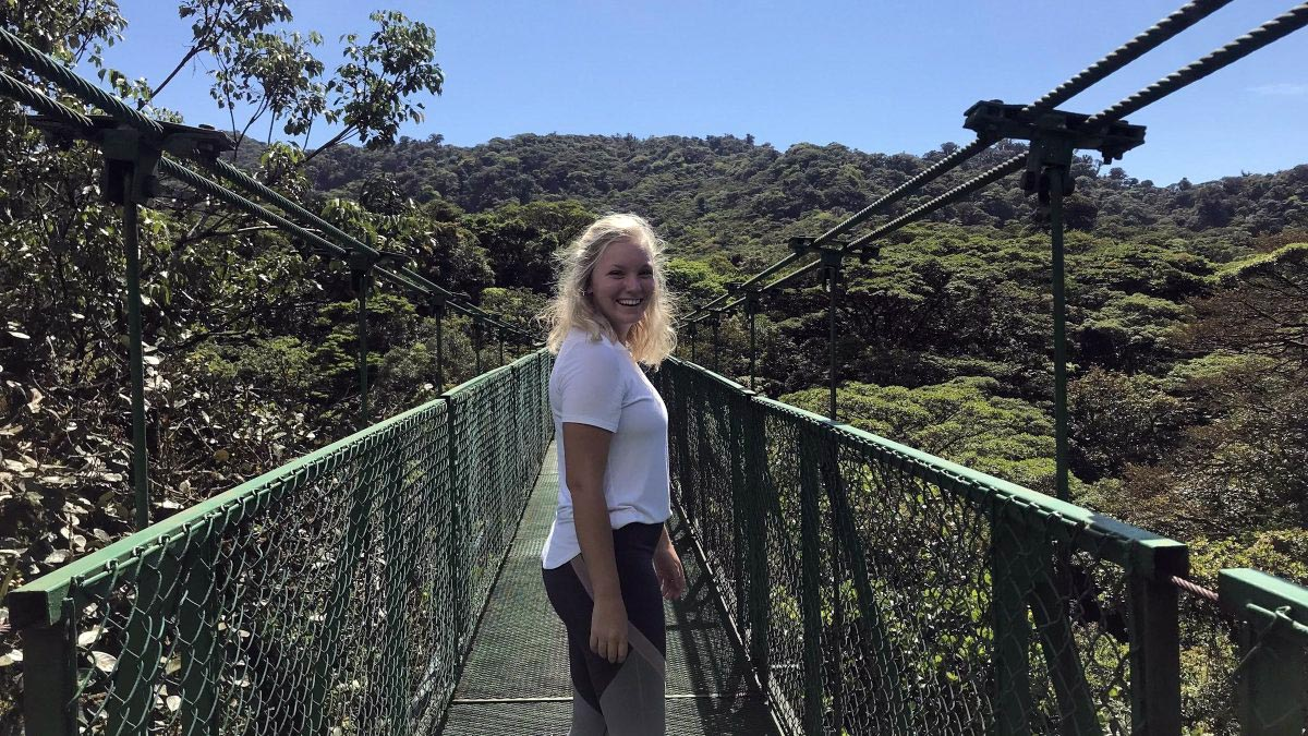Kaylee Nye poses on a bridge in the cloud forest of Monteverde, Costa Rica