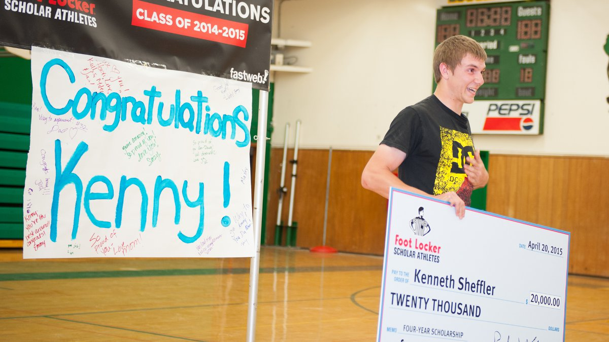 Kenny Sheffer showing an emotional display of gratitude after receiving a $20,000 scholarship.