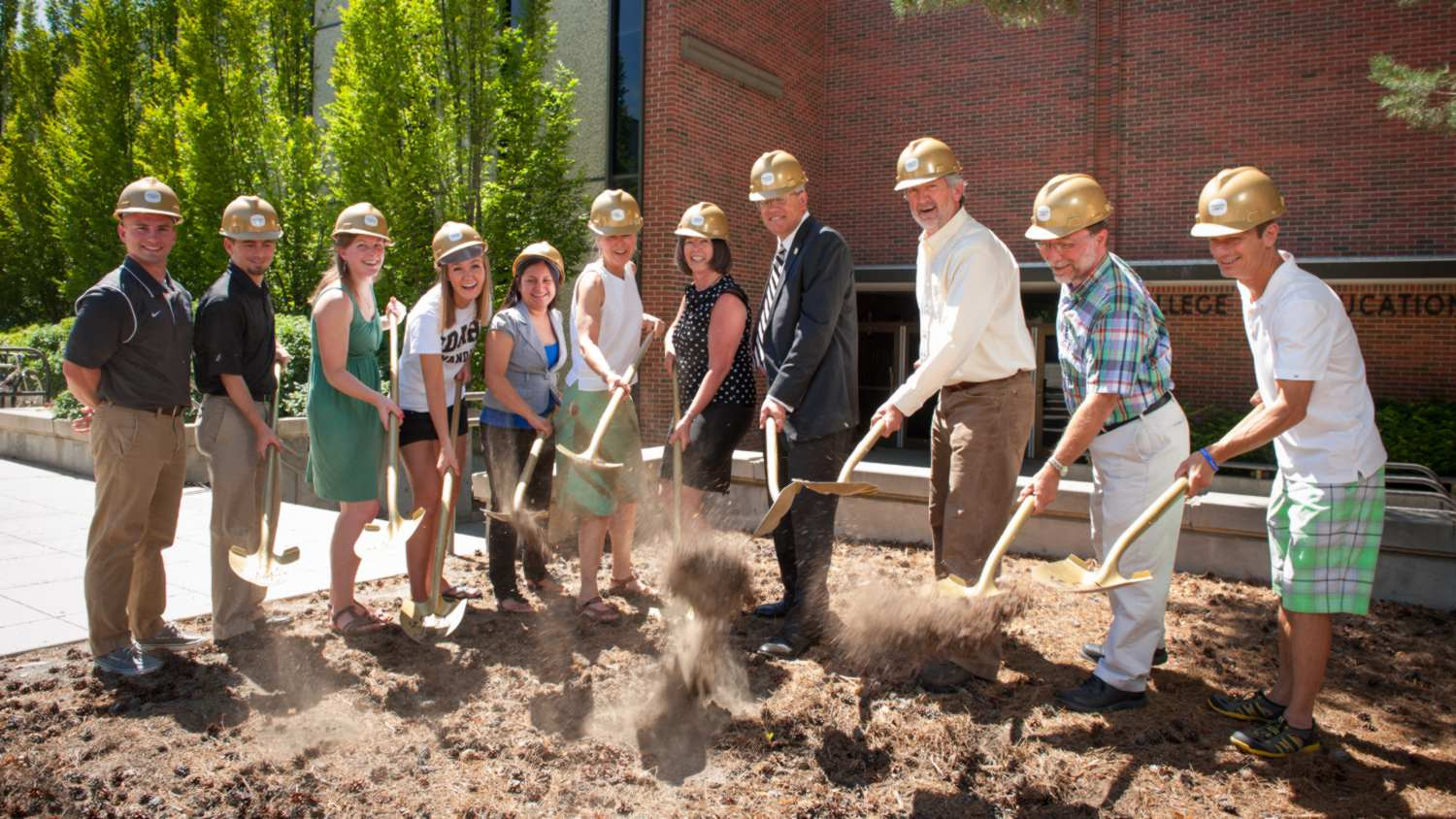 President Chuck Staben and faculty with shovels and hardhats at the groundbreaking ceremony.