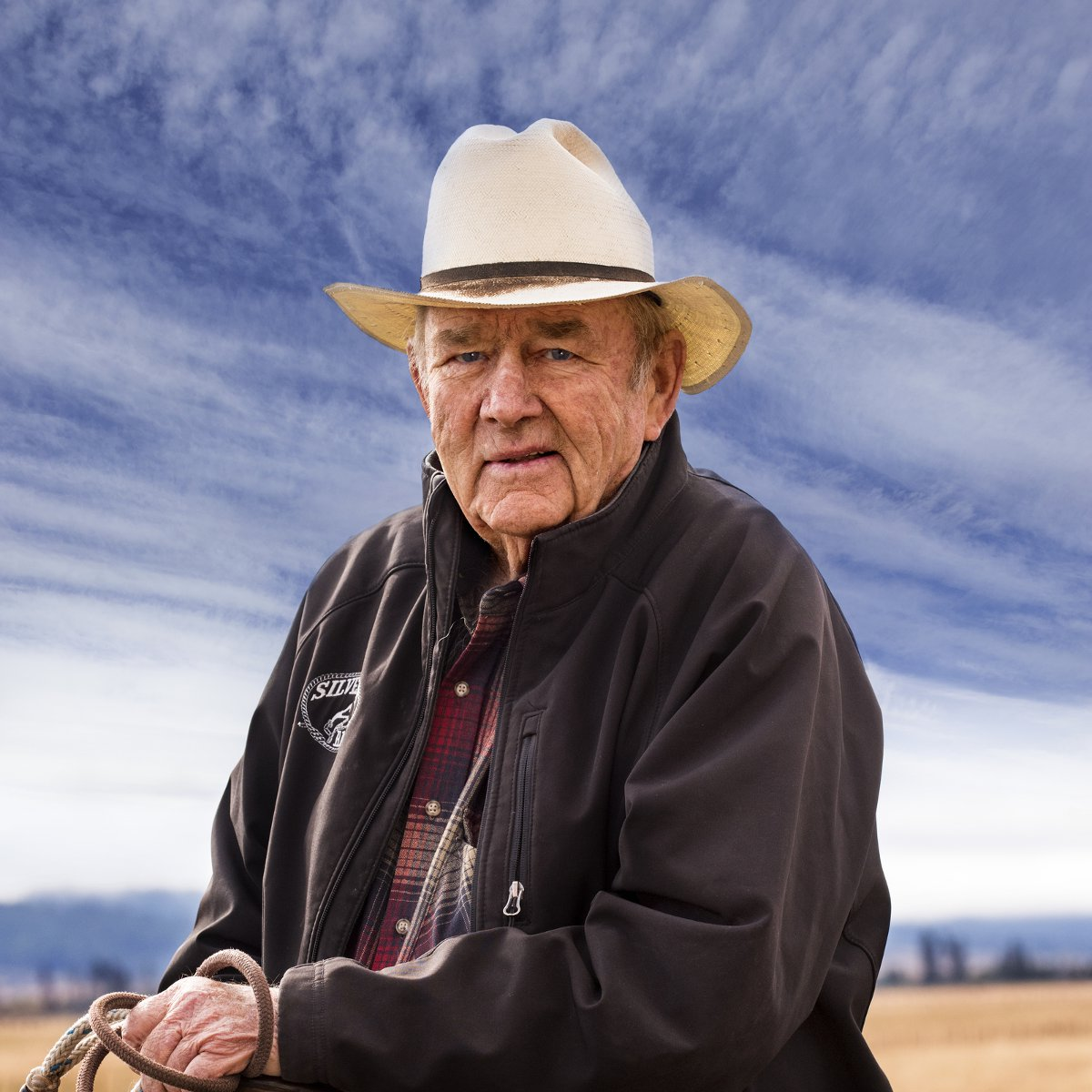 Harry L. Bettis sits on horseback at his southern Idaho cattle ranch.