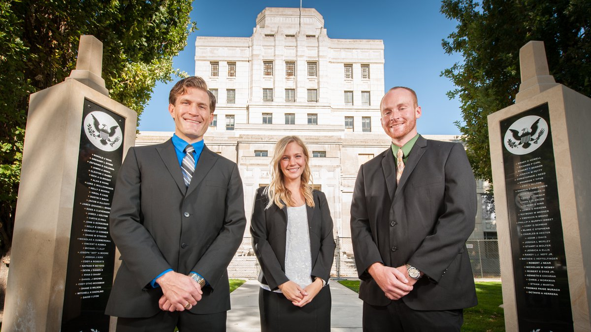 Three law students stand in front of the newly renovated law building in Boise.