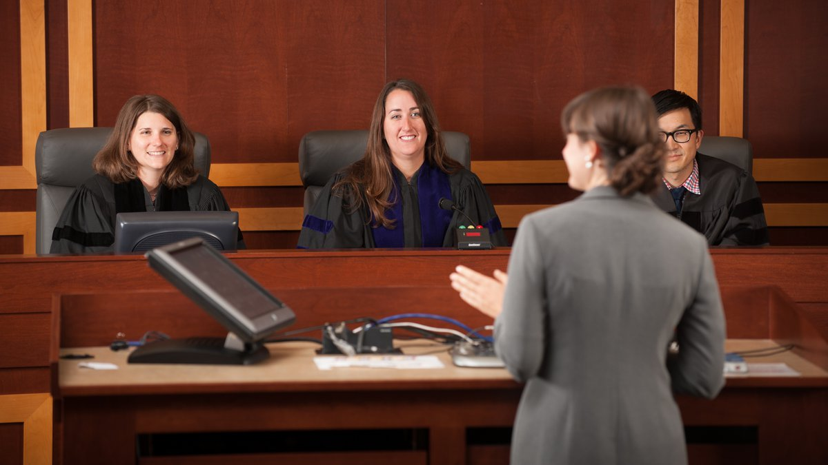 Law students participating in a mock court setting.