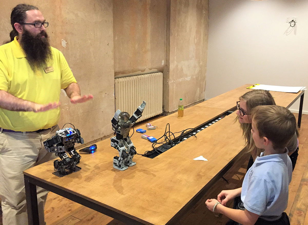 Tim Morgan and children with robots