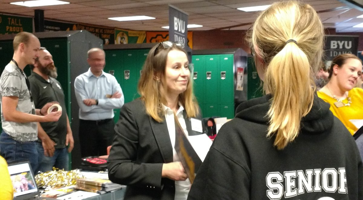 Lidiia Ostrom speaks to potential students at the SE Idaho College Fair.