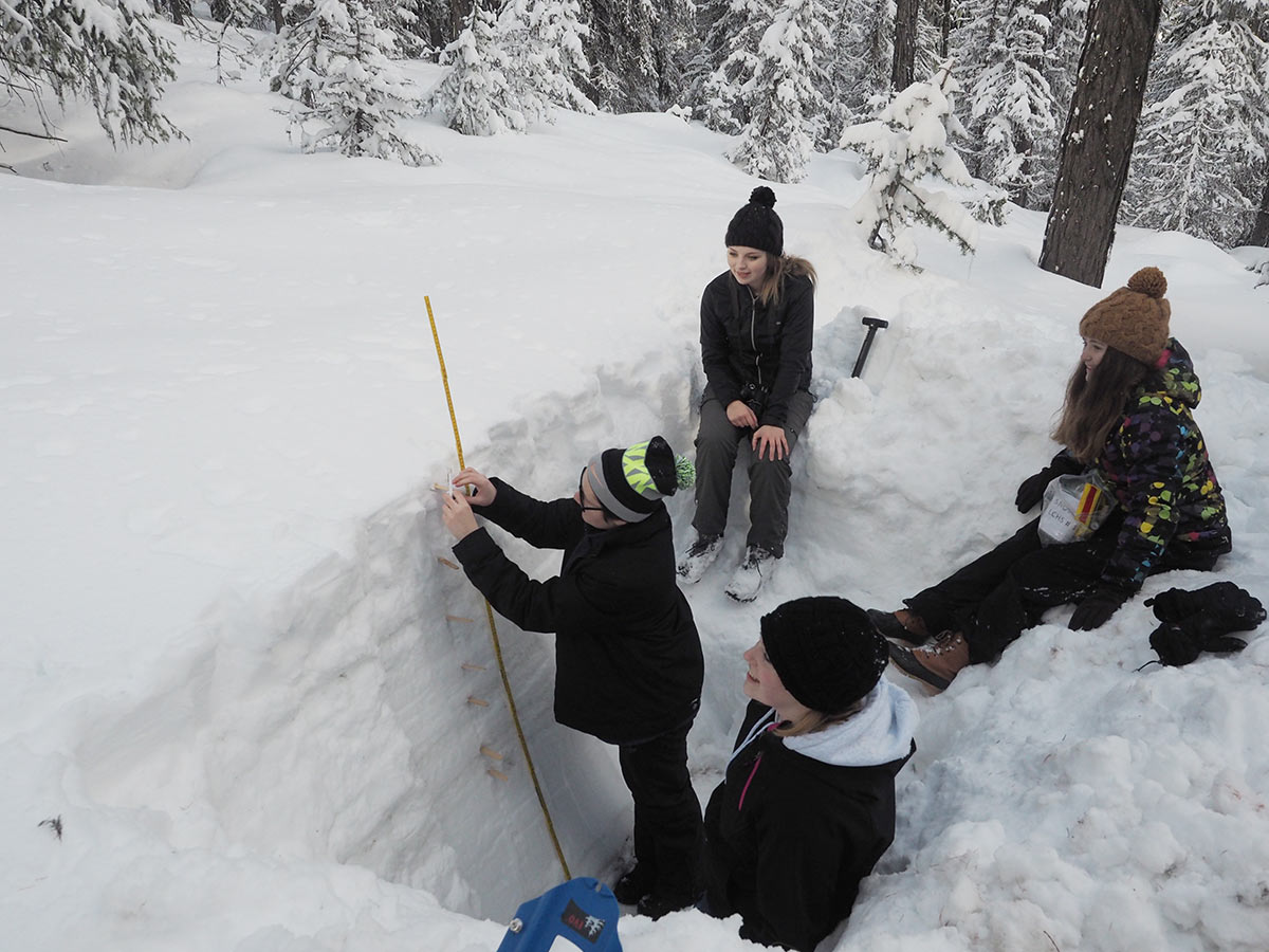 students measure snow pack