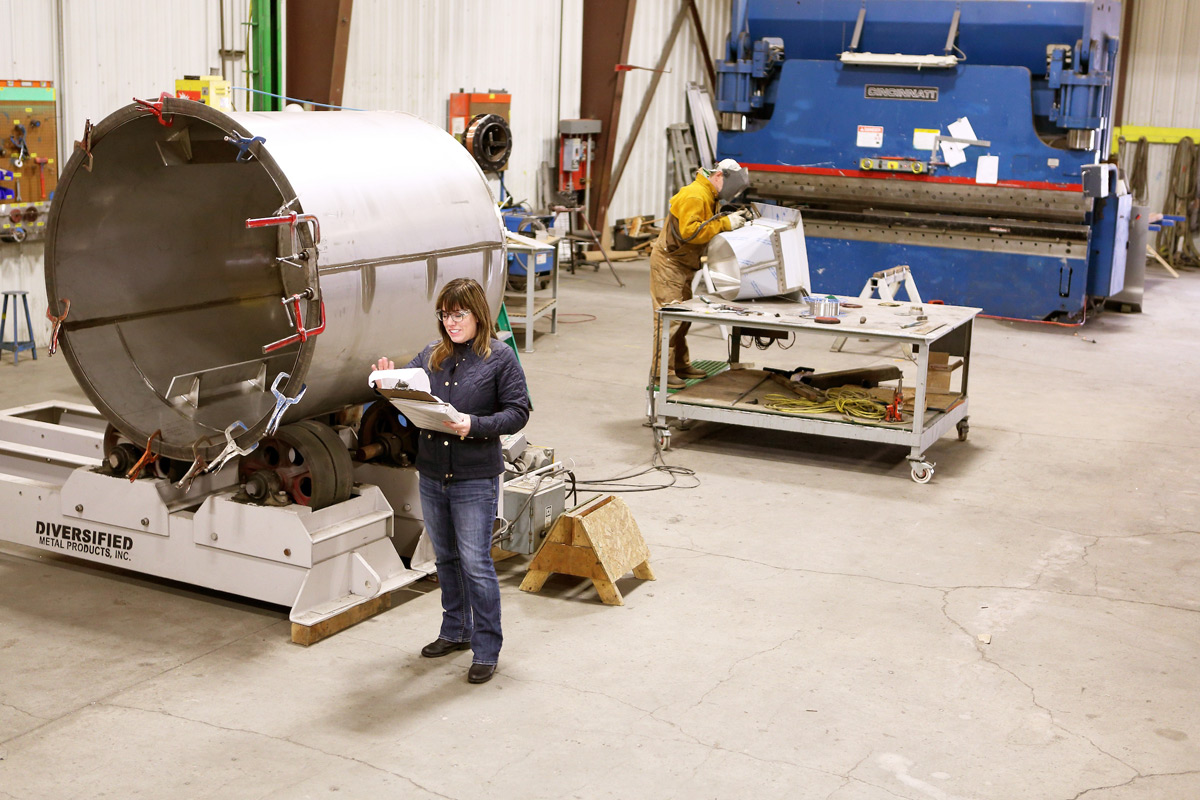 Rebecca McClellan inspects production in the workshop at Diversified Metal Products in Idaho Falls.