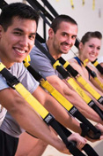 Students participate in the TRX wellness class at the Student Recreation Center