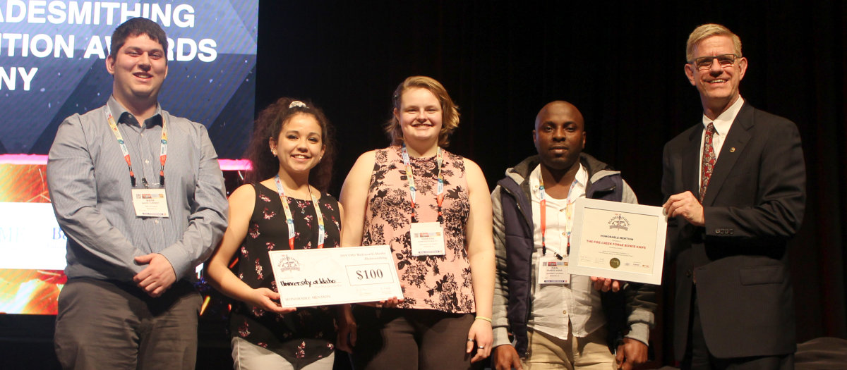 Engineering students Mark Currier, Jadzia Graves, Vanessa Beasley and Saheed Adisa accept their award for honorable mention during the 2019 Bladesmithing Competition hosted by The Minerals, Metals and Materials Society.