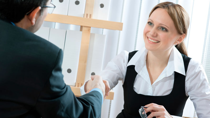 Human resource woman shaking hands with male customer