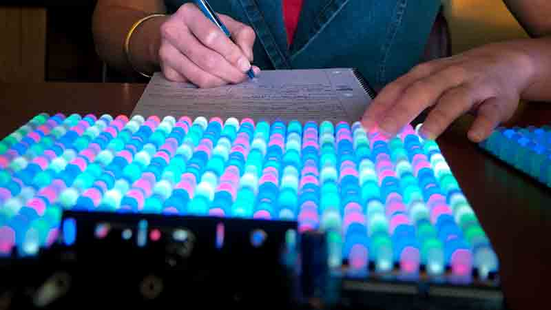 A University of Idaho Student works on a LED light board in a lab at the University of Idaho