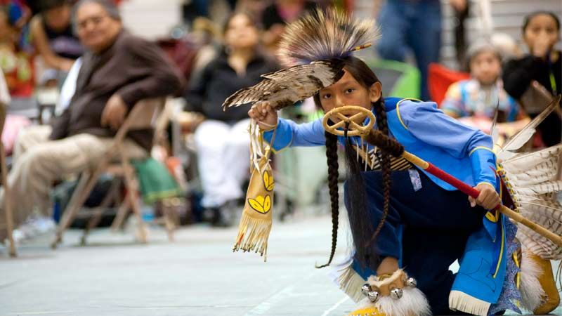 Young Native American boy in full regalia