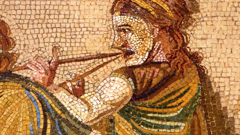 Greek Mosaic of a man playing a flute