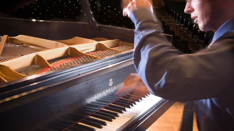Graduate student playing the piano