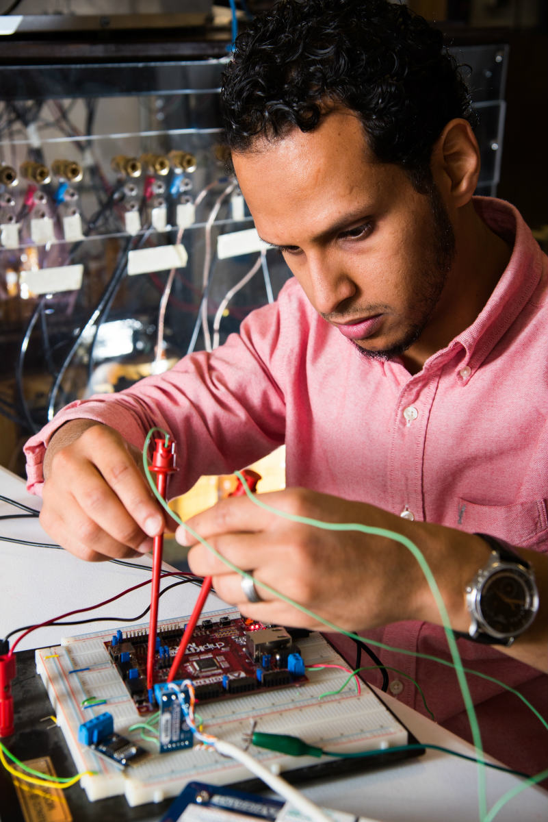 Mohammed working on electric circuit