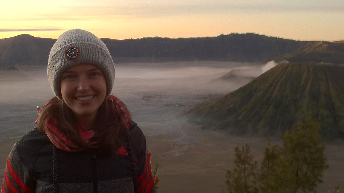 Carly Joerger, with an Indonesian volcano in the background.