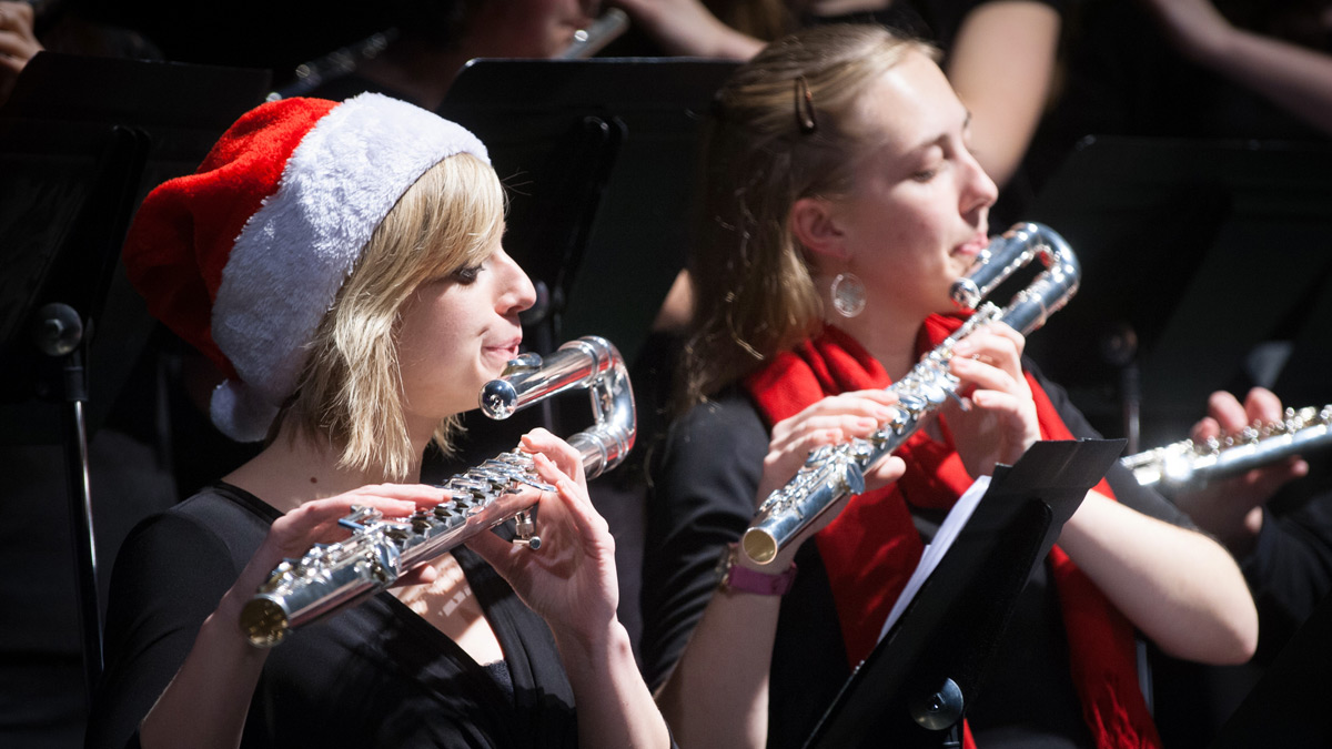 Two students play alto flutes in the 2014 Holiday Concert.
