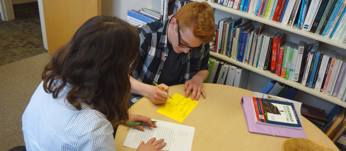 Two students working in the Writing Center.