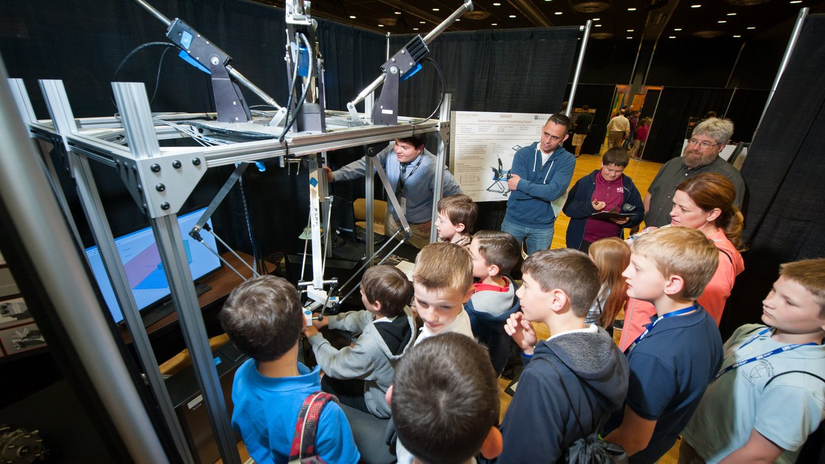 A group of young local students view a demo at the annual engineering expo.