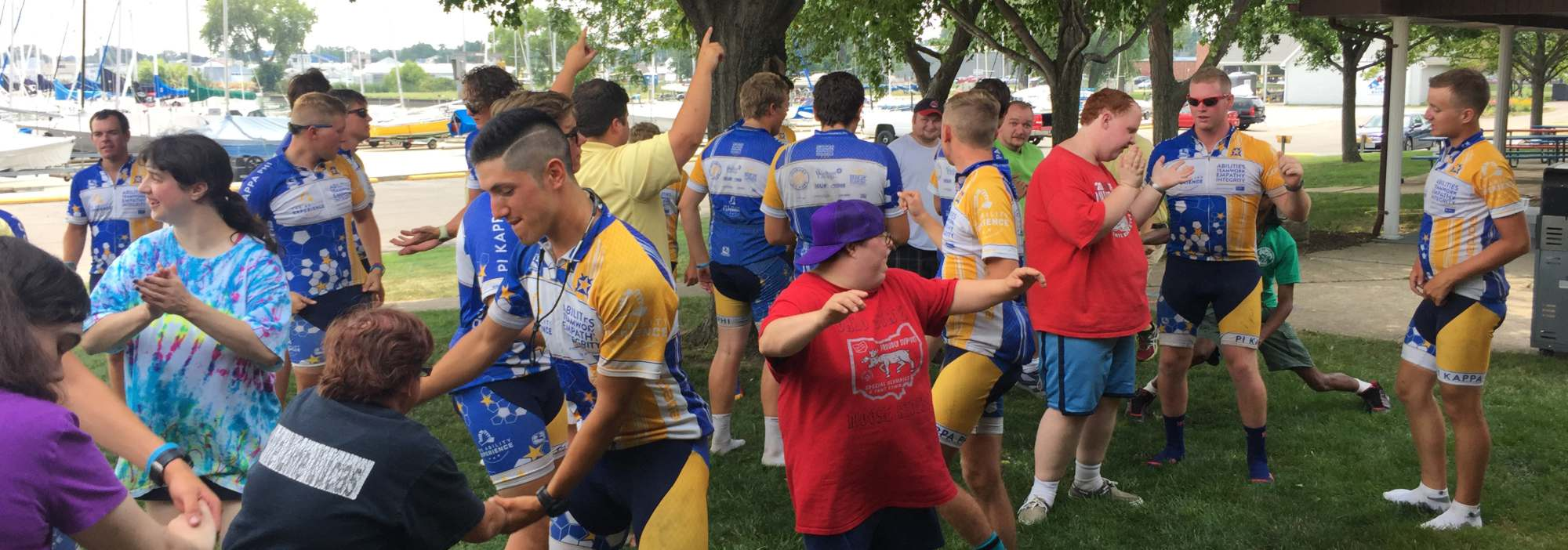 Members of Pi Kappa Phi stretch out and prepare to bike with a group from the Ability Experience.